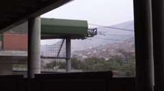 Metro Cable cars coming in for boarding in Medellin - stock footage