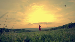 A panorama of a girl happily flying her kite Stock Footage