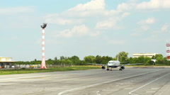 Jet plane on runway landing, moving to its final position Stock Footage