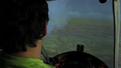 Young man pretending to be a pilot, playing video game in flight simulator Stock Footage