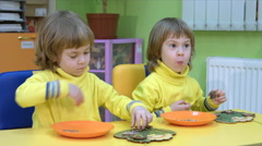 Twins play in a logical toy Stock Footage