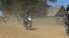 Group of bikers who hit the road leaving clouds of dust in their wake Stock Footage