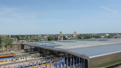 Roof over Central Station Rotterdam with trains. Stock Footage