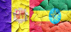 Andorra flag with Ethiopia flag on a grunge cracked wall Stock Illustration