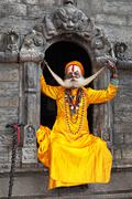 A sadhu at Pashupatinath Temple - stock photo