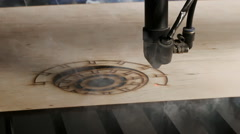 Laser cutting on wood. Slow motion - stock footage