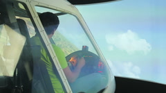 Male pilot learning to navigate aircraft in flight simulator, playing video game Stock Footage