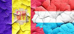 Andorra flag with Luxembourg flag on a grunge cracked wall Stock Illustration