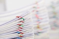 Pile overload paperwork have blur pile overload document as background - stock photo