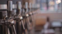 Taps of Craft Beer In Pub, Rack Focus Stock Footage
