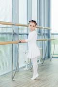 Little ballerina girl. Adorable child dancing classical ballet in a white studio Kuvituskuvat