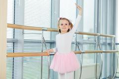 The young girl dances in a ballet tutu in the hall - stock photo