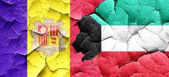 Andorra flag with Kuwait flag on a grunge cracked wall Stock Illustration