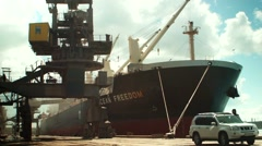 Loading grain in big ship at Odessa port - stock footage