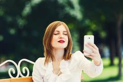 Young woman with tablet pc in the park Stock Photos
