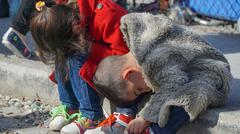 LESVOS, GREECE - NOVEMBER 15, 2015: Refugee children eat. Refugees in the camp Kuvituskuvat