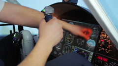 Pilot's hand knocking on breakdown cockpit panel, flight control system error Stock Footage