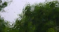 Big raindrops splashing on window during heavy rain shower Stock Footage