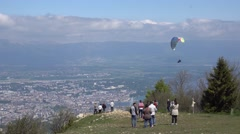 Paragliding in the blue sky in summer - stock footage