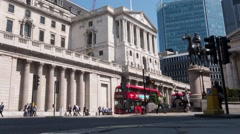 Wide time lapse of commuters and traffic outside the Bank of England - stock footage