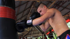 MMA Fighter Muay Thai Boxing Training Hitting Heavy Bag Stock Footage