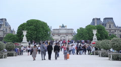 People having a rest in Jardin des Tuileries in Paris Stock Footage