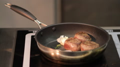 Meat being cooked in a stove Stock Footage