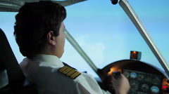 Strained pilot maneuvering aircraft in dangerous turbulence zone, risk of crash Stock Footage