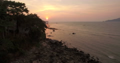 Sunset At Patong Beach In Phuket Ascending Aerial Pullback Shot Stock Footage