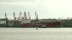 Big Ship Moored at port and tow boat Stock Footage