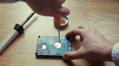 Repairman unfixing a computer motherboard. Macro - stock footage