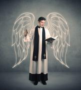 young priest in giving his blessing - stock photo
