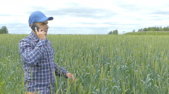 Farmer in a plaid shirt controlled his field.Talking on the phone. Stock Footage