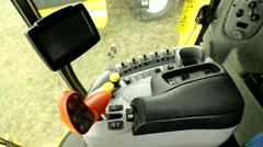 New Holland combine cabin at field Stock Footage
