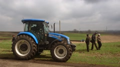 New Holland tractor at field Stock Footage