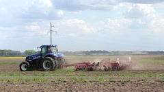 New Holland tractor plowing field Stock Footage