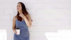 Young woman enjoying a cup of takeaway coffee Stock Footage