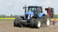 New Holland tractor plows in the field Stock Footage