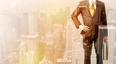 Business man looking at overlay city background Stock Photos