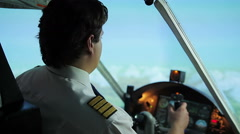 Airplane captain switching to autopilot mode, writing flight details in document Stock Footage