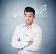 Smiling business guy with graph arrow - stock photo