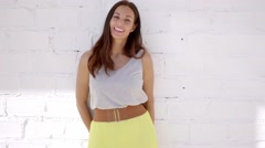 Adorable and sensual woman posing against wall - stock footage