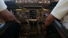 Two pilots in the cockpit of a passanger airplane Stock Footage
