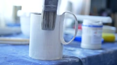 Young woman making a new clay mug at her workshop Stock Footage