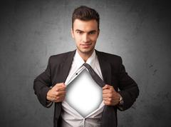 Businessman tearing off his shirt with white copyspace on chest Stock Photos