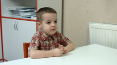 Little boy at the Desk - stock footage