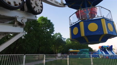 Large carousel at an amusement park. A great wheel turns slowly. - stock footage