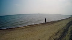 Man walking by the sea in Southend-on-Sea Stock Footage