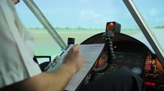 Aircrew captain signing flight plan, taking steering wheel, ready for takeoff Stock Footage