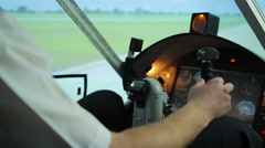 Light aircraft pilot preparing for takeoff, checking flight route in documents Stock Footage